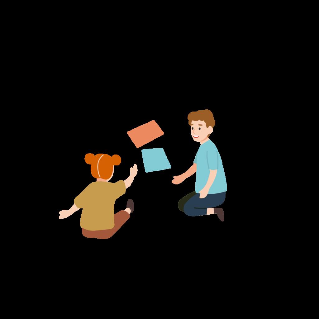 Två barn som leker med böcker
